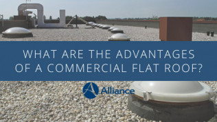 What are the advantages of a commercial flat roof?